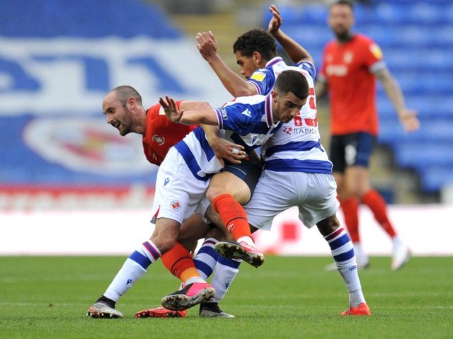 Danny Hylton is sandwiched by two Reading defenders during Tuesday night's 1-0 win over the Royals