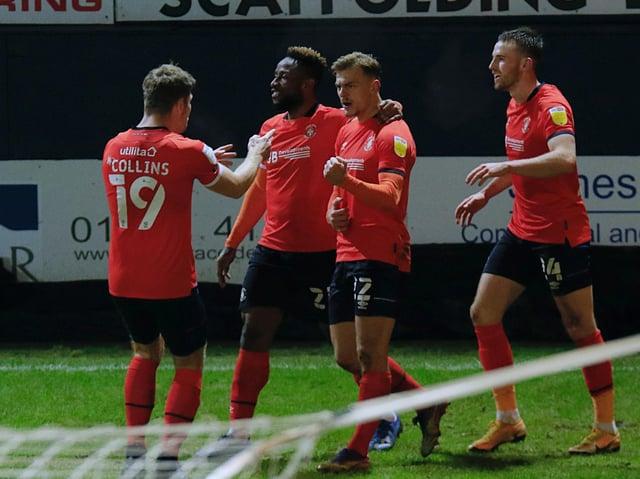 Kiernan Dewsbury-Hall celebrates his first goal for Luton during last night's 2-1 win over Bristol City