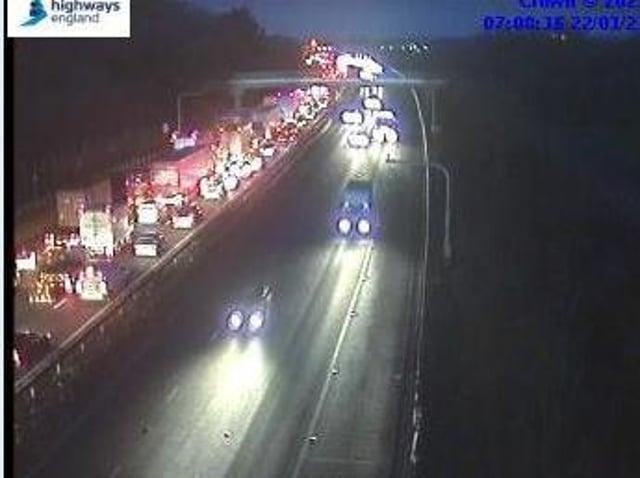 Highways England jam cams showed traffic queuing on the M1 heading towards Milton Keynes on Friday morning