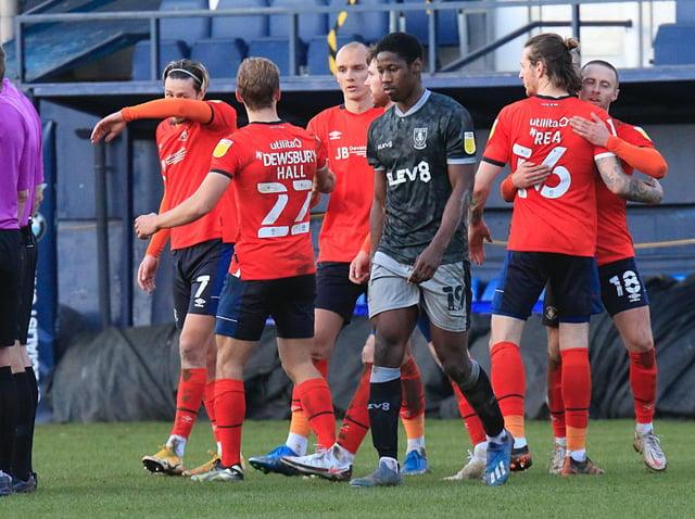 Luton players celebrate beating Sheffield Wednesday 3-2 on Saturday