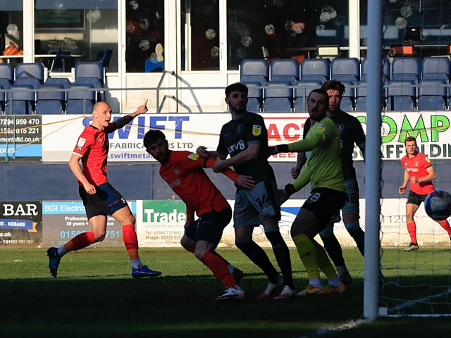 Kal Naismith gets Luton's comeback underway by pulling one back for the Hatters on Saturday