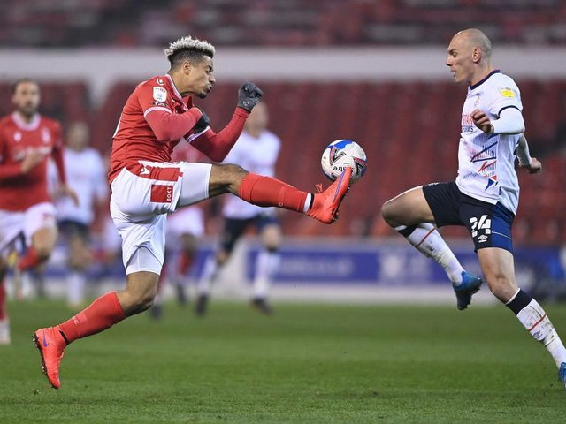 Kal Naismith makes a challenge on Nottingham Forest substitute Lyle Taylor