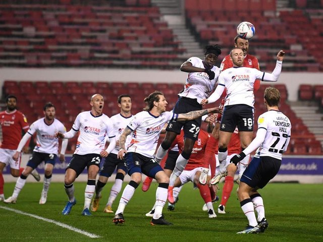 Luton defend a corner at the City Ground this evening