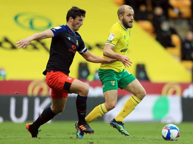 Matty Pearson tries to win the ball from Teemu Pukki on Saturday