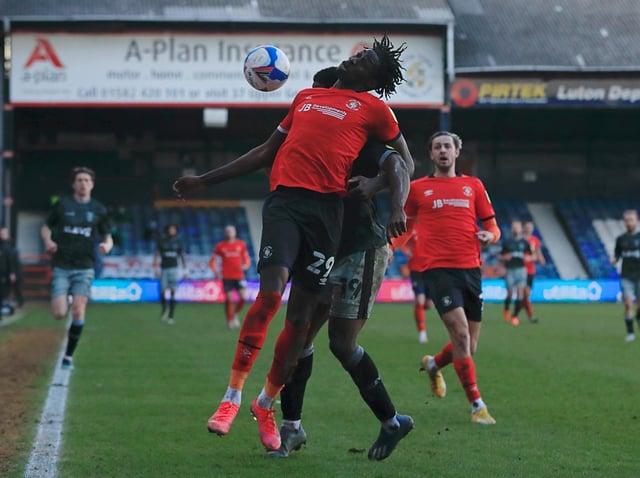 Elijah Adebayo in action for the Hatters