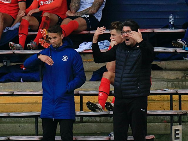 Luton first team coach Chris Cohen and assistant manager Mick Harford