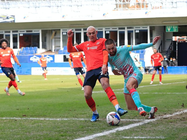 Kal Naismith makes a challenge during today's 1-0 defeat to Swansea