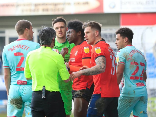 Luton have words with referee Darren Bond during their 1-0 defeat to Swansea on Saturday