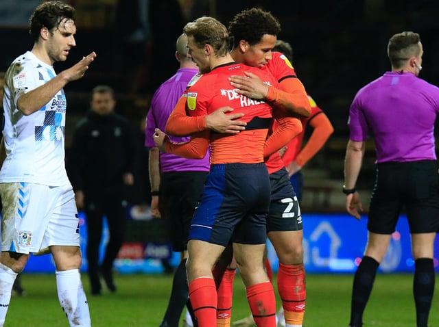 Kiernan Dewsbury-Hall and Sam Nombe celebrate Luton's 2-0 win over Coventry