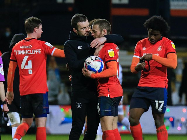 Nathan Jones gives Jordan Clark a hug after Tuesday night's win over Coventry City