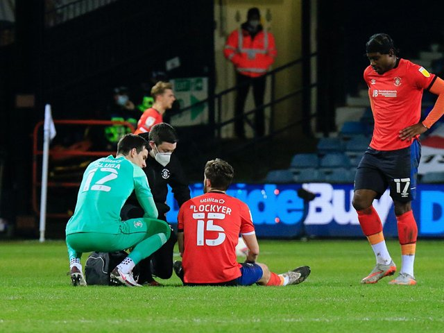 Tom Lockyer suffered an ankle injury against Cardiff City last month