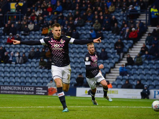 James Collins celebrates making it 1-1 from the penalty spot at Preston last season