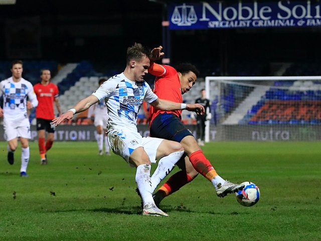 Town striker Sam Nombe gets stuck in against Coventry on Tuesday night