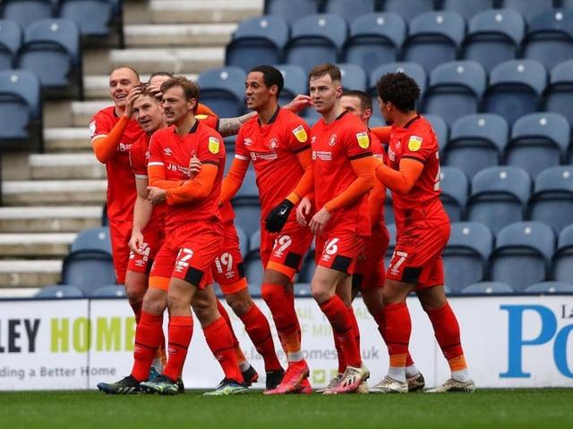Luton celebrate their winning goal at Preston