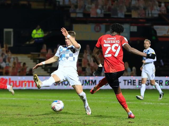 Elijah Adebayo goes for goal against Coventry