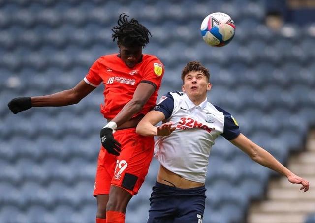 Elijah Adebayo gets up to win a header against Preston