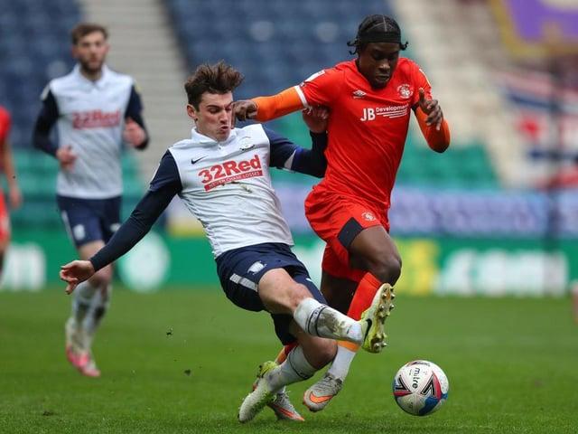 Hatters midfielder Pelly-Ruddock Mpanzu charges forward against Preston