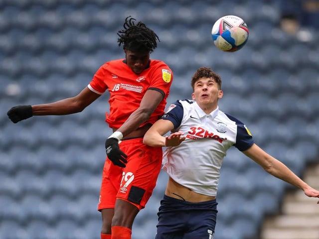 Elijah Adebayo wins a header for the Hatters against Preston