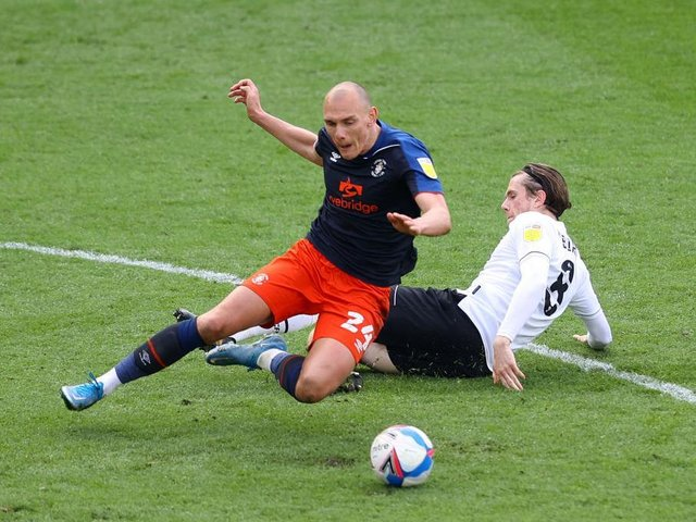 Kal Naismith is felled during Luton's 2-0 defeat at Derby