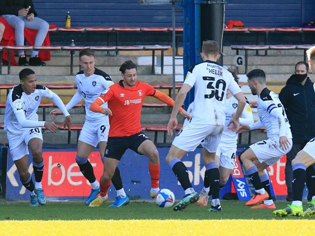 Harry Cornick is put under pressure during Town's 2-1 defeat to Barnsley