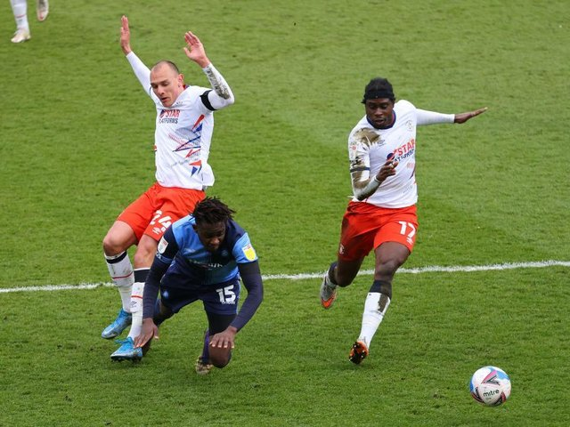 Town defender Kal Naismith concedes a penalty against Wycombe this afternoon