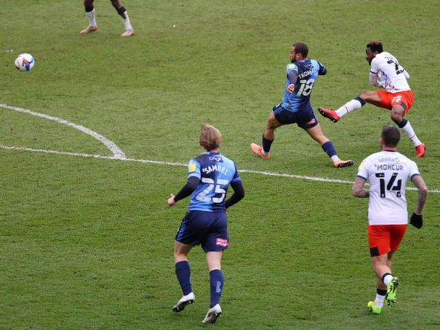 Kazenga LuaLua scores his stunning strike against Wycombe on Saturday