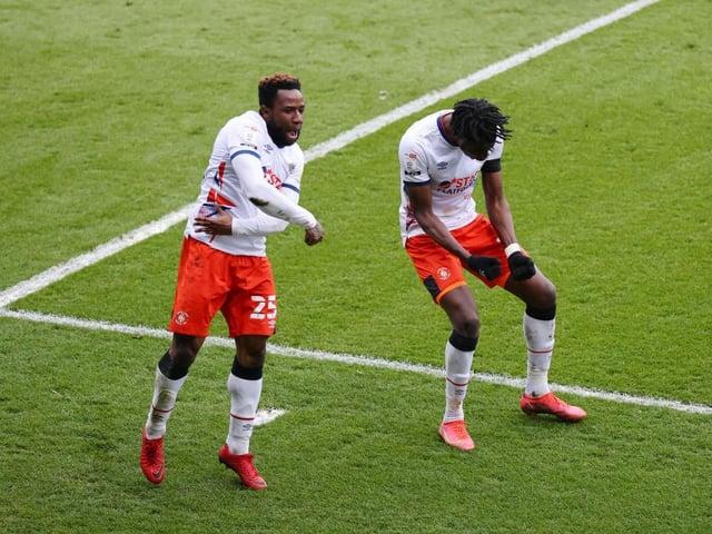 Kazenga LuaLua and Elijah Adebayo celebrate the striker's header making it 3-1 at Wycombe on Saturday