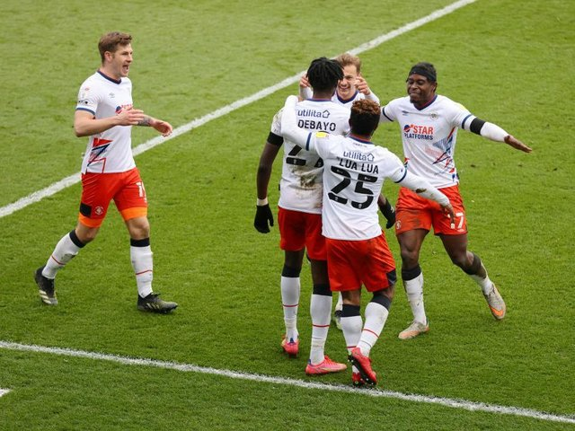 Luton's players celebrate with Elijah Adebayo after the forward made it 3-1 on Saturday