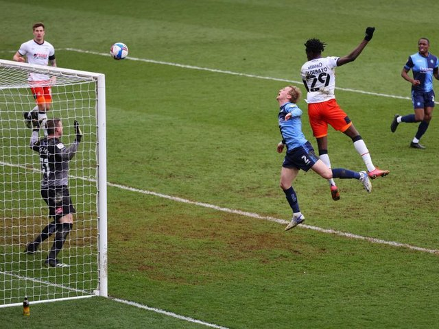 Elijah Adebayo heads home Luton's third goal at Wycombe on Saturday