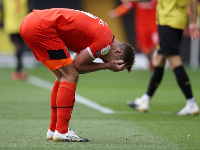James Collins can't hide his frustration after missing a glorious chance at Watford earlier in the season
