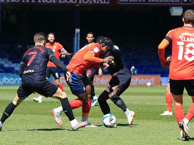 Pelly-Ruddock Mpanzu gets stuck in against Watford