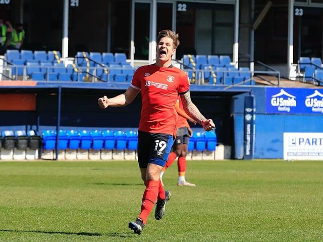 James Collins celebrates Luton's 1-0 win over Watford