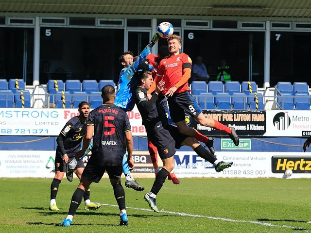 Luke Berry goes up for a header against Watford on Saturday