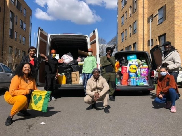(Left to right), Kandi Sharma, Shirley Small, Ryan Lewis, Aiden Lewis, Bernie Abby, Kaleem Lewis, Melodie Nanton and Ken Young with two vans of donations received in 48 hours