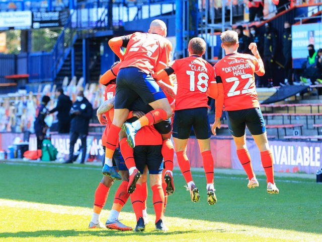 Luton's players celebrate James Collins' winning penalty against Watford