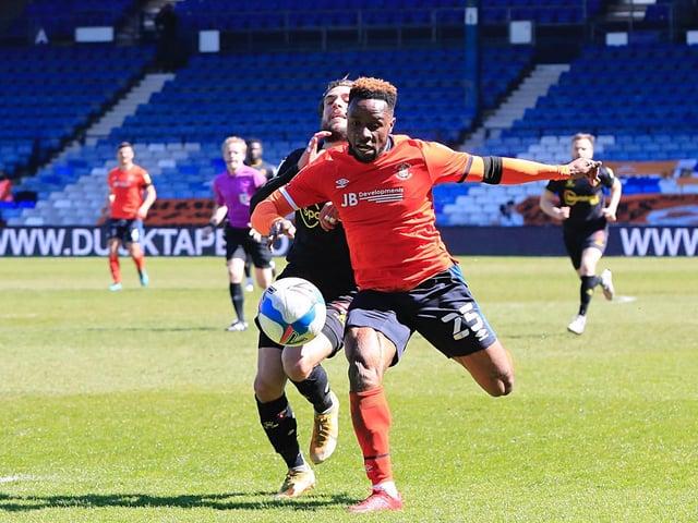 Kazenga LuaLua is fouled by Watford defender Kiko Femenia