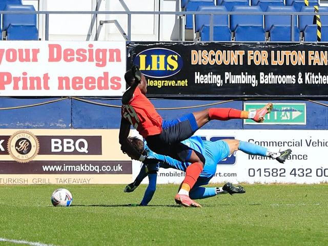 Elijah Adebayo is fouled by Watford keeper Daniel Bachmann for Luton's match-winning penalty on Saturday