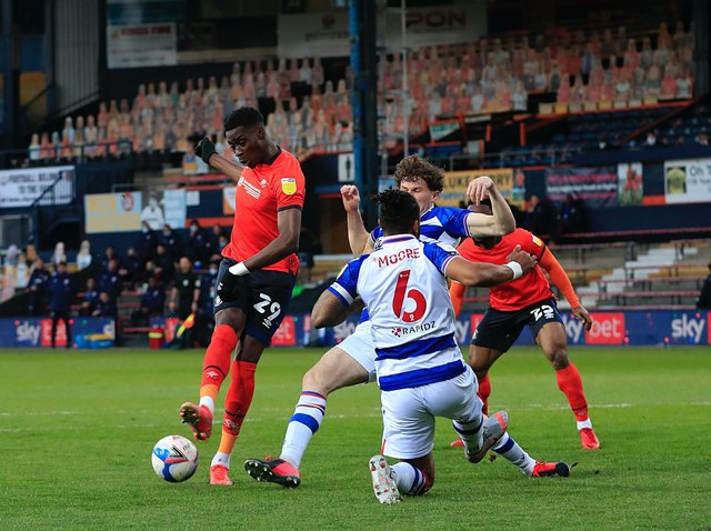 Elijah Adebayo goes for goal against Reading this evening