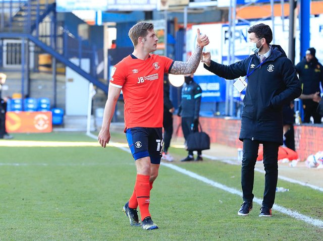 Luton striker James Collins gives a thumbs up after beating Watford