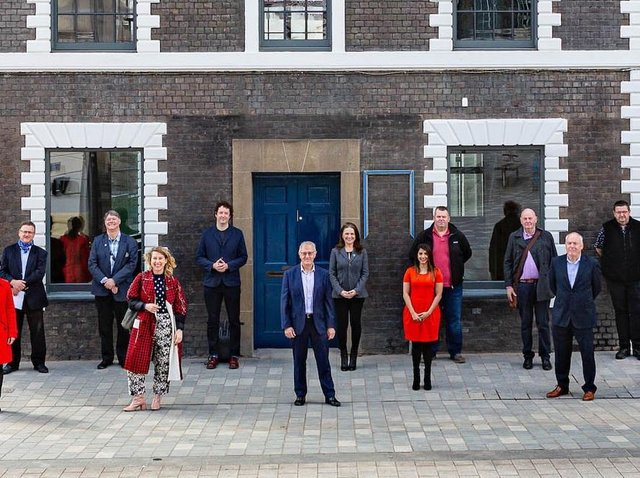 Project staff outside the carefully restored Hat Works building on Guildford Street