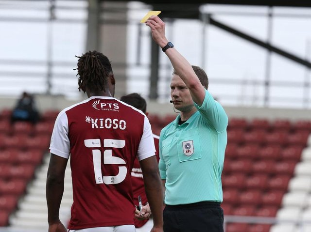 Peter Kioso is booked for Northampton against Blackpool