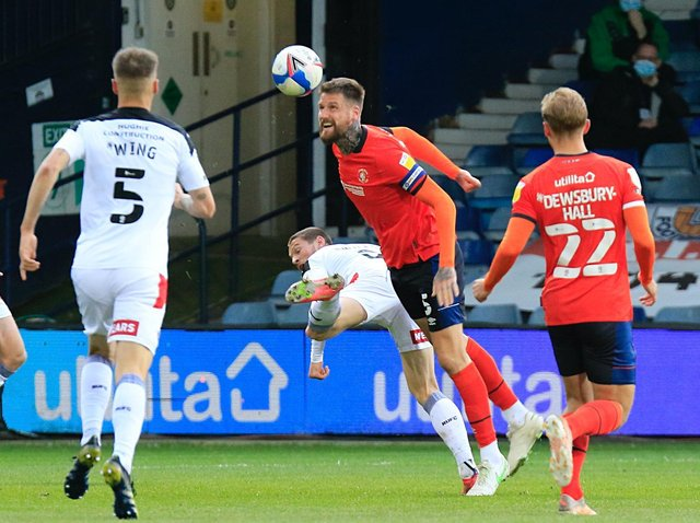 Sonny Bradley heads away during the goalless draw with Rotherham United