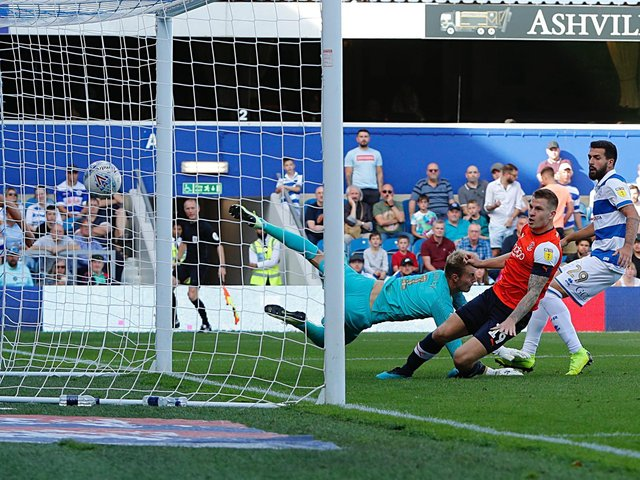 James Collins scores for the Hatters in their 3-2 defeat at QPR last season