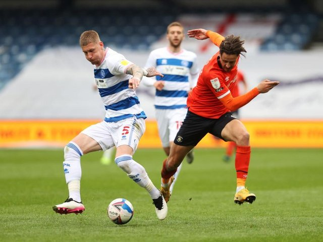 Harry Cornick tries to race away against Derby County this afternoon