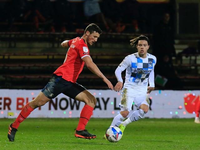 Defender Matty Pearson has left Luton for Huddersfield