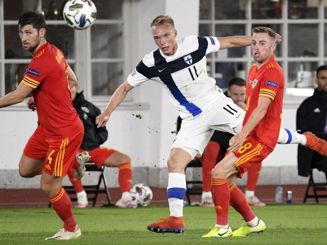 Joe Morrell in action for Wales