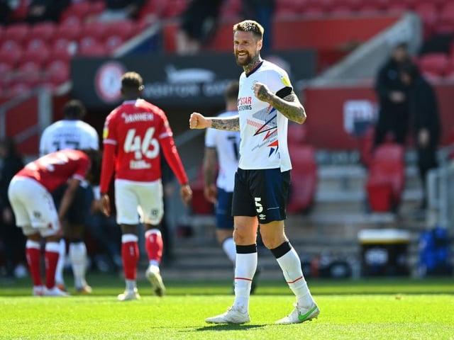 Town skipper Sonny Bradley celebrates a win at Bristol City last season