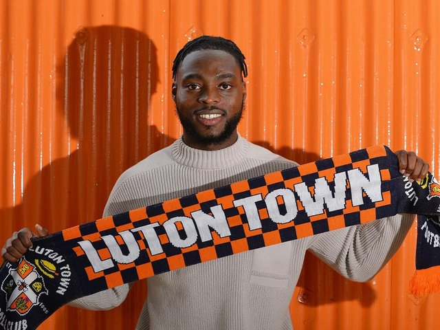 Fred Onyedinma signs for the Hatters