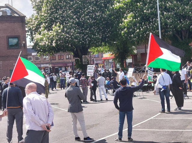 The protest took place outside Crescent Hall in Bury Park