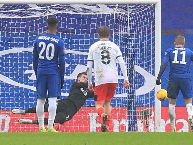 Simon Sluga saves from the penalty spot against Chelsea last season